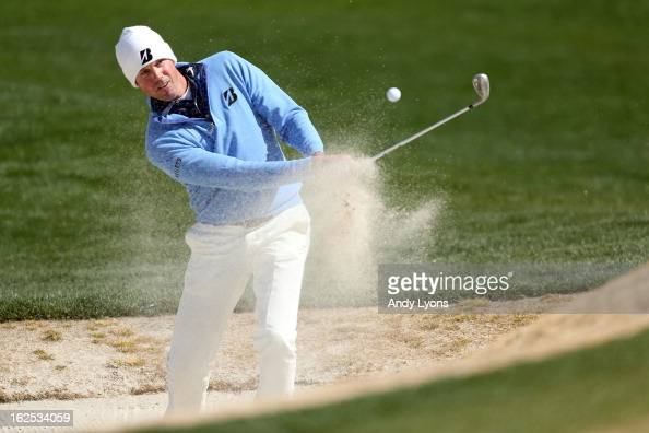 Matt Kuchar hits his third shot on the fifth hole out of the bunker during the final round of the World Golf Championships Accenture Match Play at...