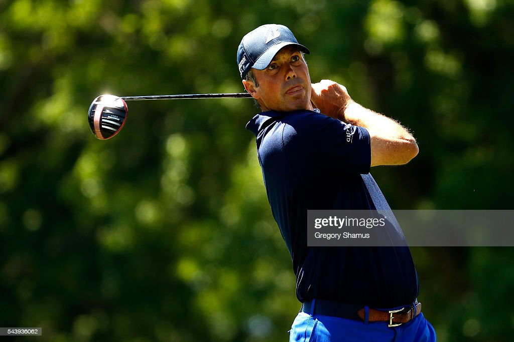 <a gi-track='captionPersonalityLinkClicked' href=/galleries/search?phrase=Matt+Kuchar&family=editorial&specificpeople=243226 ng-click='$event.stopPropagation()'>Matt Kuchar</a> hits off the third tee during the first round of the World Golf Championships - Bridgestone Invitational at Firestone Country Club South Course on June 30, 2016 in Akron, Ohio.