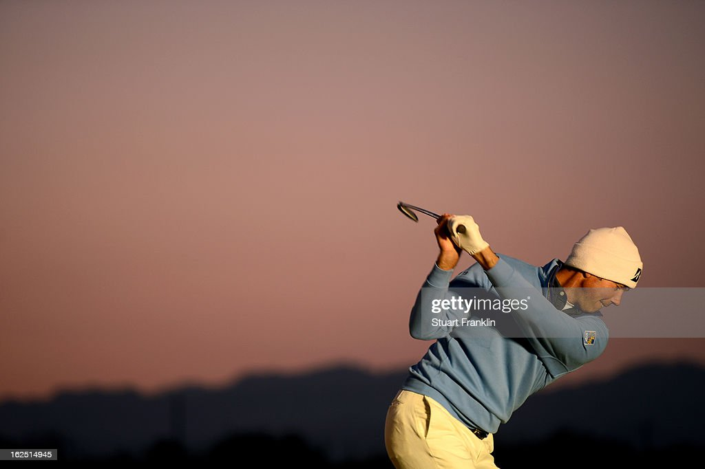 <a gi-track='captionPersonalityLinkClicked' href=/galleries/search?phrase=Matt+Kuchar&family=editorial&specificpeople=243226 ng-click='$event.stopPropagation()'>Matt Kuchar</a> hits practice balls on the range prior to his semifinal round match of the World Golf Championships - Accenture Match Play at the Golf Club at Dove Mountain on February 24, 2013 in Marana, Arizona.