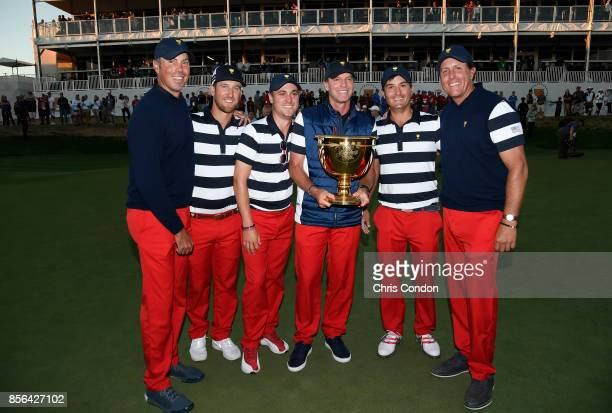 Matt Kuchar Kevin Chappell Justin Thomas Captain Steve Stricker Kevin Kisner and Phil Mickelson of the US Team celebrate with the trophy after they...