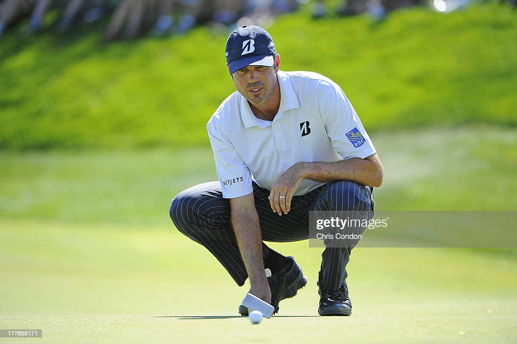 Matt Kuchar lines up a putt on the 7th green during the final round of The Barclays at Liberty National Golf Club on August 25, 2013 in Jersey City, New Jersey.