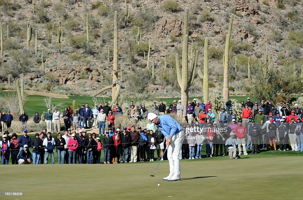 Matt Kuchar makes a putt attempt on the green during the final round of the World Golf Championships - Accenture Match Play at the Golf Club at Dove Mountain on February 24, 2013 in Marana, Arizona.