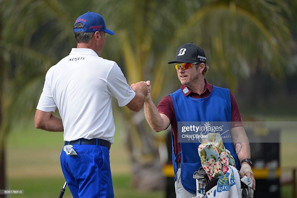 Matt Kuchar makes an eagle on the 9th hole and celebrates with caddie John Wood during the second round of the Sony Open in Hawaii at Waialae Country Club on January 15, 2016 in Honolulu, Hawaii.