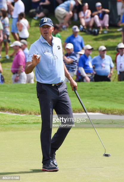 Matt Kuchar motions to the gallery after sinking a putt on the 18th hole during the second round of the PGA Championship on August 11 2017 at Quail...
