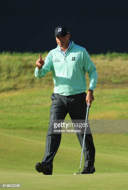 Matt Kuchar of the United States acknowledges the crowd on the 18th green during the first round of the 146th Open Championship at Royal Birkdale on...