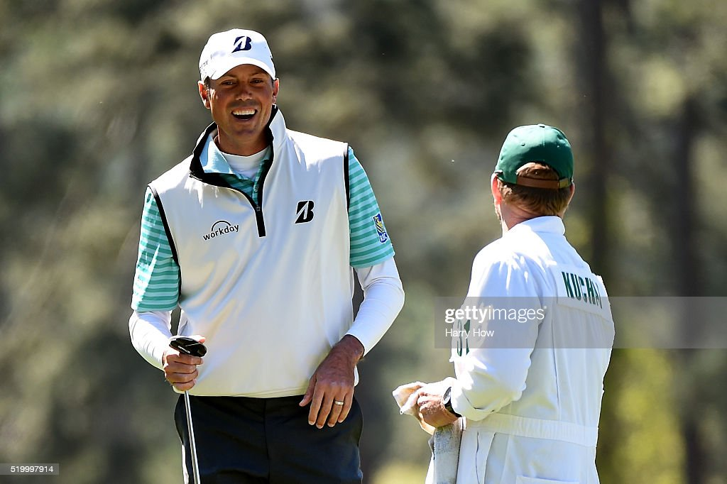 Matt Kuchar of the United States and caddie John Wood react to his birdie on the third hole during the third round of the 2016 Masters Tournament at Augusta National Golf Club on April 9, 2016 in Augusta, Georgia.