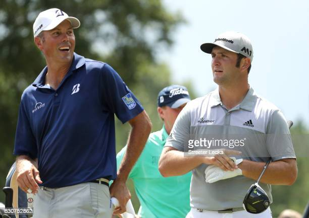 Matt Kuchar of the United States and Jon Rahm of Spain wait to tee off on the third hole during the third round of the 2017 PGA Championship at Quail...