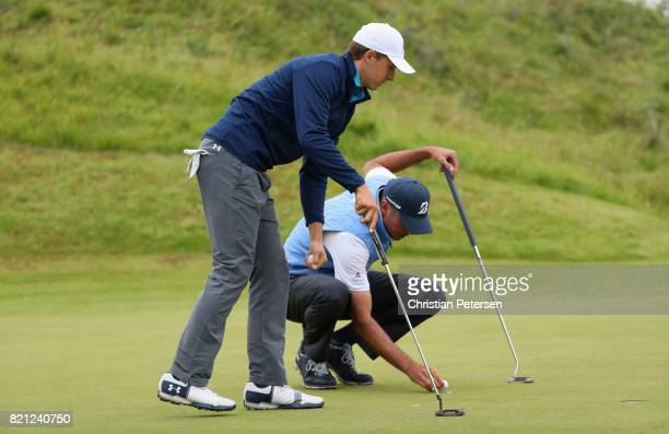 Matt Kuchar of the United States and Jordan Spieth of the United States on the 12th green during the final round of the 146th Open Championship at...