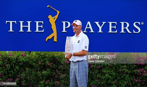 Matt Kuchar of the United States celebrates with the trophy awarded after his twostroke victory during the final round to win THE PLAYERS...