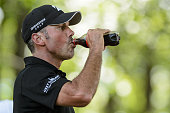 Matt Kuchar of the United States drinks while walking from the eleventh tee during round three of the 2016 RBC Canadian Open at Glen Abbey Golf...