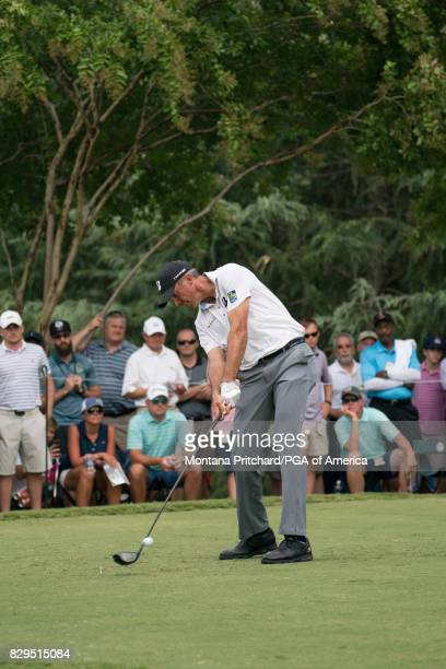 Matt Kuchar of the United States hits his tee shot on the 11th hole during Round One for the 99th PGA Championship held at Quail Hollow Club on...