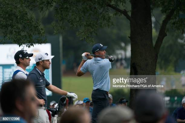 Matt Kuchar of the United States hits his tee shot on the tenth hole during Round Two for the 99th PGA Championship held at Quail Hollow Club on...