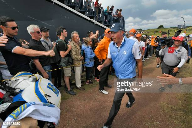 Matt Kuchar of the United States is greeted by fans along the eighth hole during the final round of the 146th Open Championship at Royal Birkdale on...