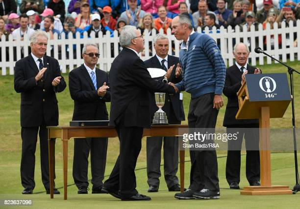 Matt Kuchar of the United States is presented with the Silver Salver for second place at the 146th Open Championship at Royal Birkdale on July 23...