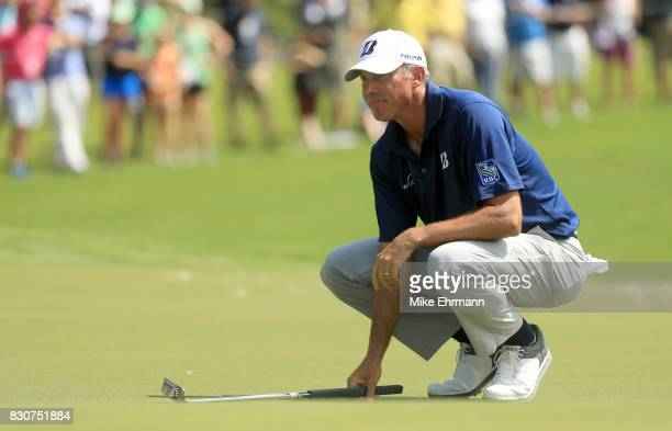 Matt Kuchar of the United States lines up a putt on the first green during the third round of the 2017 PGA Championship at Quail Hollow Club on...