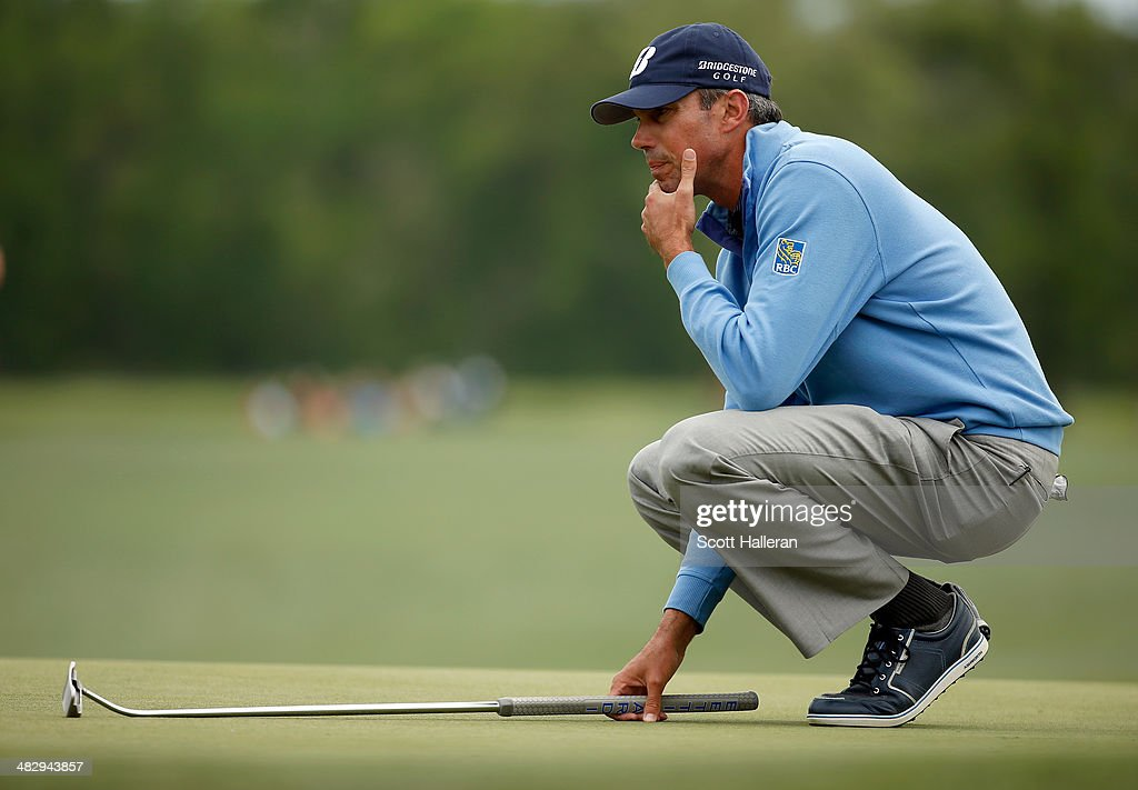 Matt Kuchar of the United States lines up his shot on the green of the eighteenth hole during round three of the Shell Houston Open at the Golf Club of Houston on April 5, 2014 in Humble, Texas.