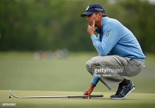 Matt Kuchar of the United States lines up his shot on the green of the eighteenth hole during round three of the Shell Houston Open at the Golf Club...