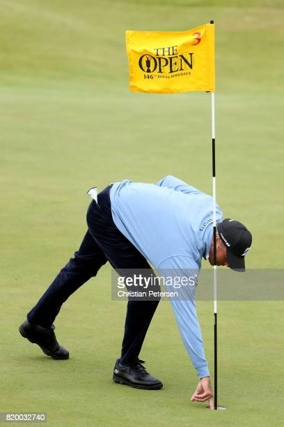 Matt Kuchar of the United States picks his ball out of the hole after chipping in on the 3rd green during the second round of the 146th Open...