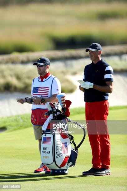 Matt Kuchar of the United States plays his second shot on the 14th hole in his match against Charl Schwartzel of the International Team during the...