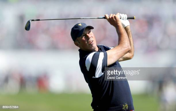Matt Kuchar of the United States plays his second shot on the first hole in his match against Charl Schwartzel of the International Team during the...