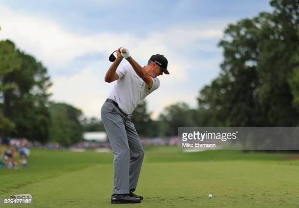 Matt Kuchar of the United States plays his shot from the eighth tee during the first round of the 2017 PGA Championship at Quail Hollow Club on...