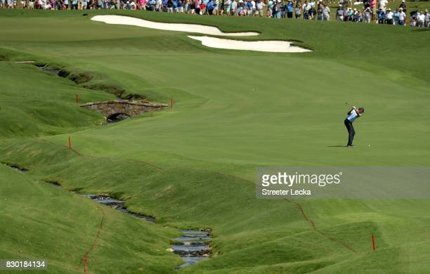 Matt Kuchar of the United States plays his shot on the 18th hole during the second round of the 2017 PGA Championship at Quail Hollow Club on August...