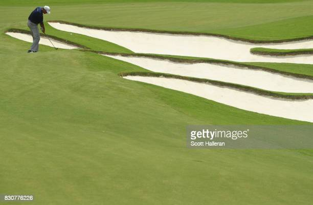 Matt Kuchar of the United States plays his shot on the fifth hole during the third round of the 2017 PGA Championship at Quail Hollow Club on August...