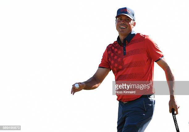 Matt Kuchar of the United States reacts after putting for par on the 18th green during the final round of men's golf on Day 9 of the Rio 2016 Olympic...