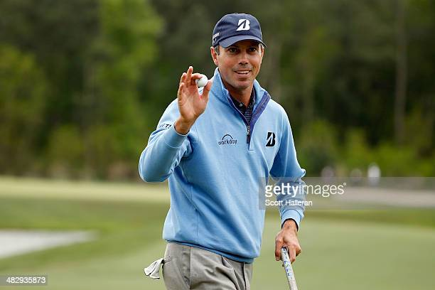 Matt Kuchar of the United States reacts on the green after putting for birdie on the twelfth hole during round three of the Shell Houston Open at the...