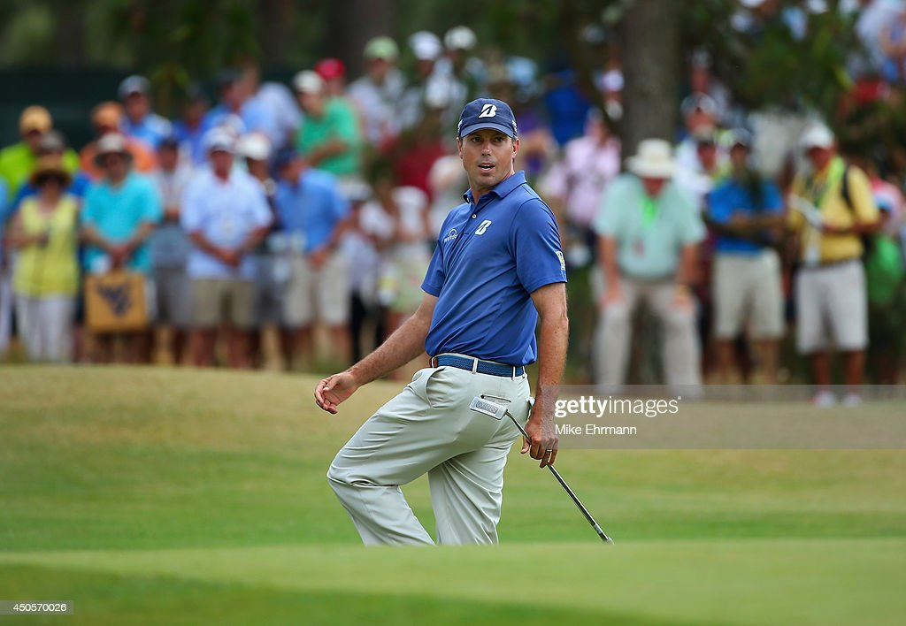 <a gi-track='captionPersonalityLinkClicked' href=/galleries/search?phrase=Matt+Kuchar&family=editorial&specificpeople=243226 ng-click='$event.stopPropagation()'>Matt Kuchar</a> of the United States reacts to a missed putt for birdie on the 15th hole during the second round of the 114th U.S. Open at Pinehurst Resort & Country Club, Course No. 2 on June 13, 2014 in Pinehurst, North Carolina.