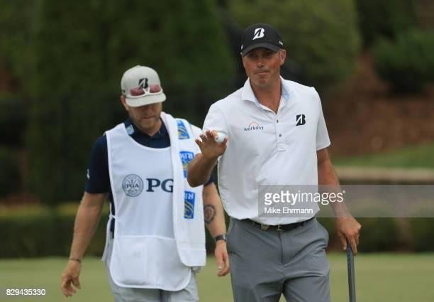 Matt Kuchar of the United States reacts to his putt on the seventh hole during the first round of the 2017 PGA Championship at Quail Hollow Club on...