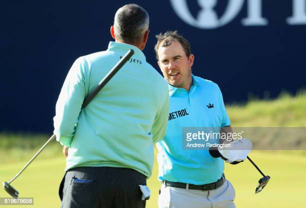 Matt Kuchar of the United States shakes hands with Richie Ramsay of Scotland on the 18th green during the first round of the 146th Open Championship...