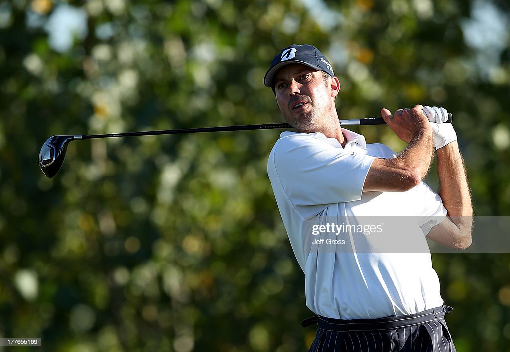 Matt Kuchar of the United States tees off on the 18th hole during the final round of The Barclays at Liberty National Golf Club on August 25, 2013 in Jersey City, New Jersey.