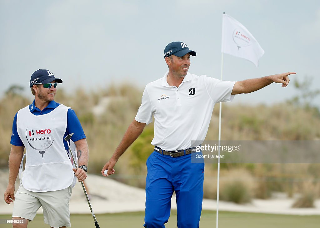 Matt Kuchar of the United States walks off the first green with his caddie John Wood during the second round of the Hero World Challenge at Albany, The Bahamas on December 4, 2015 in Nassau, Bahamas