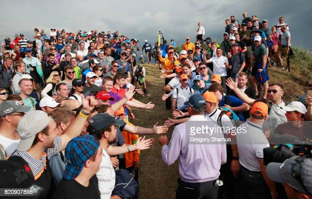 Matt Kuchar of the United States walks through a corridor of fans during the third round of the 146th Open Championship at Royal Birkdale on July 22...