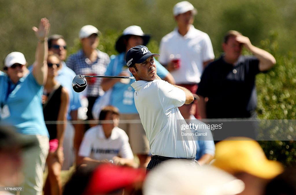 Matt Kuchar of the United States watches his tee shot on the third hole during the final round of The Barclays at Liberty National Golf Club on August 25, 2013 in Jersey City, New Jersey.
