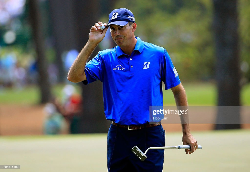 <a gi-track='captionPersonalityLinkClicked' href=/galleries/search?phrase=Matt+Kuchar&family=editorial&specificpeople=243226 ng-click='$event.stopPropagation()'>Matt Kuchar</a> of the United States waves after making a putt for birdie on the third hole during the third round of the 2014 Masters Tournament at Augusta National Golf Club on April 12, 2014 in Augusta, Georgia.