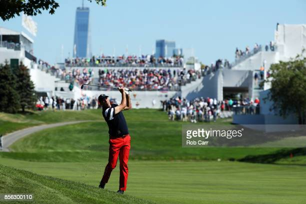 Matt Kuchar of the US Team plays a shot on the first hole during Sunday singles matches of the Presidents Cup at Liberty National Golf Club on...