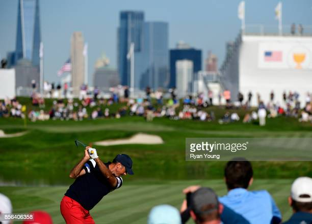 Matt Kuchar of the US Team plays his shot from the 18th tee during the Sunday singles matches at the Presidents Cup at Liberty National Golf Club on...