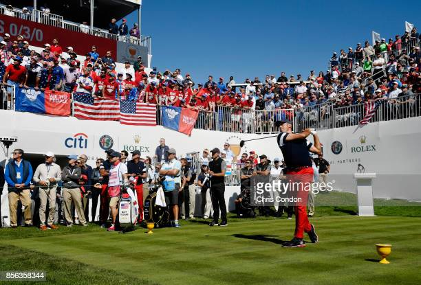 Matt Kuchar of the US Team plays his shot from the first tee during the Sunday singles matches at the Presidents Cup at Liberty National Golf Club on...