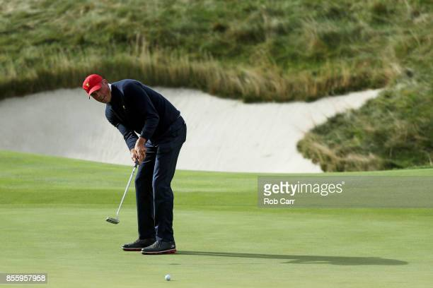 Matt Kuchar of the US Team putts on the 11th green during Saturday foursome matches of the Presidents Cup at Liberty National Golf Club on September...