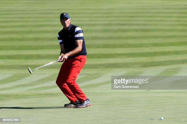 Matt Kuchar of the US Team reacts to a putt during Sunday singles matches of the Presidents Cup at Liberty National Golf Club on October 1 2017 in...