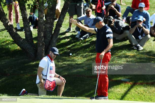 Matt Kuchar of the US Team takes a drop on the first hole during Sunday singles matches of the Presidents Cup at Liberty National Golf Club on...