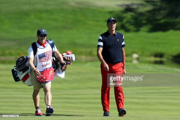 Matt Kuchar of the US Team walks on the first hole during Sunday singles matches of the Presidents Cup at Liberty National Golf Club on October 1...