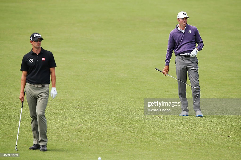 Matt Kuchar (R) of the USA and Adam Scott of Australia look ahead before an approach shot during day one of the World Cup of Golf at Royal Melbourne Golf Course on November 21, 2013 in Melbourne, Australia.