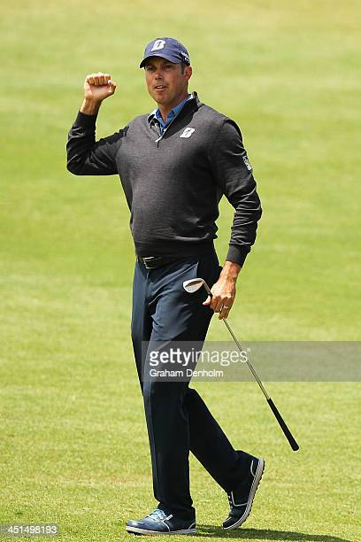Matt Kuchar of the USA celebrates after chipping to hole the 4th during day three of the World Cup of Golf at Royal Melbourne Golf Course on November...