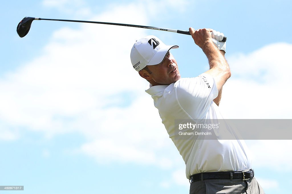 <a gi-track='captionPersonalityLinkClicked' href=/galleries/search?phrase=Matt+Kuchar&family=editorial&specificpeople=243226 ng-click='$event.stopPropagation()'>Matt Kuchar</a> of the USA hits a tee shot during day one of the World Cup of Golf at Royal Melbourne Golf Course on November 21, 2013 in Melbourne, Australia.