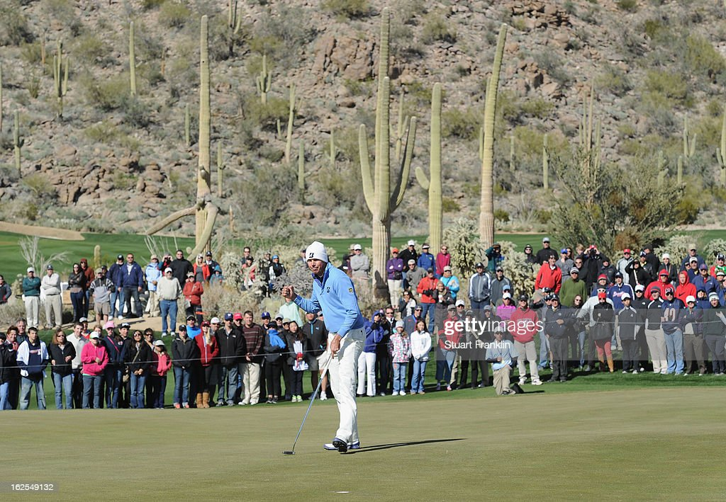 Matt Kuchar of USA celebrates his putt on the 12th hole during the final round of the World Golf Championships - Accenture Match Play at the Golf Club at Dove Mountain on February 24, 2013 in Marana, Arizona.