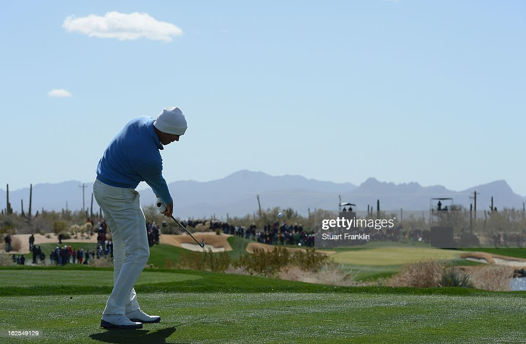 Matt Kuchar of USA plays his tee shot on the third hole during the final round of the World Golf Championships - Accenture Match Play at the Golf Club at Dove Mountain on February 24, 2013 in Marana, Arizona.