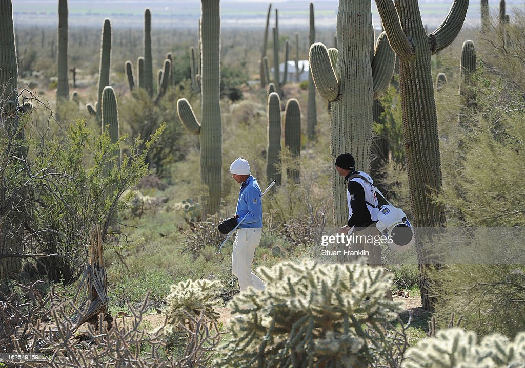 Matt Kuchar of USA walks with his caddie during the final round of the World Golf Championships - Accenture Match Play at the Golf Club at Dove Mountain on February 24, 2013 in Marana, Arizona.